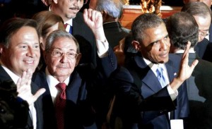 Cuba's President Raul Castro (C) holds up his left fist as his Panamanean and U.S. counterparts Juan Carlos Varela (L) and Barack Obama (R) wave before the inauguration of the VII Summit of the Americas in Panama City April 10, 2015, in this handout photo provided by the Presidency of Cuba. Picture taken April 10, 2015. REUTERS/Presidency of Cuba/Handout via Reuters   TPX IMAGES OF THE DAY     ATTENTION EDITORS - THIS PICTURE WAS PROVIDED BY A THIRD PARTY. REUTERS IS UNABLE TO INDEPENDENTLY VERIFY THE AUTHENTICITY, CONTENT, LOCATION OR DATE OF THIS IMAGE. FOR EDITORIAL USE ONLY. NOT FOR SALE FOR MARKETING OR ADVERTISING CAMPAIGNS. THIS PICTURE WAS PROCESSED BY REUTERS TO ENHANCE QUALITY. AN UNPROCESSED VERSION HAS BEEN PROVIDED SEPARATELY.