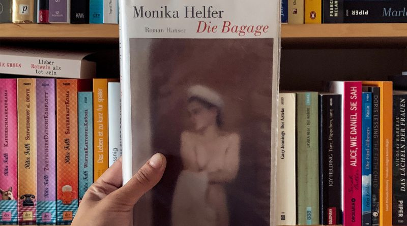 Buchcover von Die Bagage vor ein Bücherregal gehalten